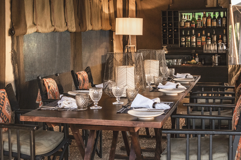 Explore-Migrational-Camps—dining-area-with-bar