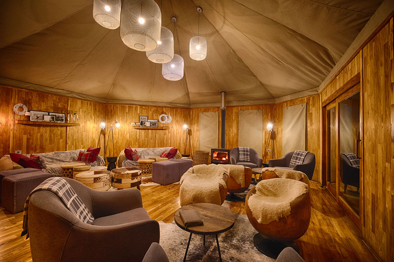 Explore-The-Highlands-cozy-lounge-with-wood-burning-stove