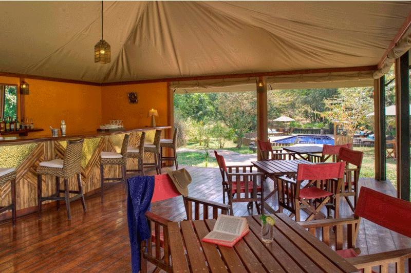Explore_olare-mara-kempinski-masai-mara-bar-by-the-pool-image2