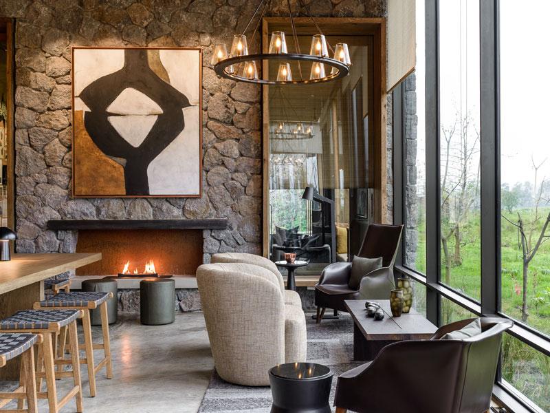Cover-Explore-Singita-Kwitonda-Lodge-Lounge-Area-with-Fireplace