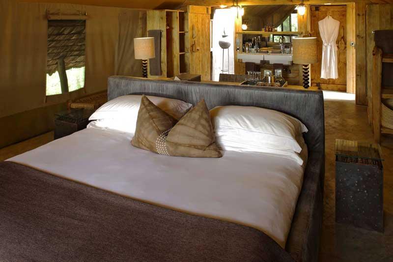 Explore_1Bed_and_vanity-andBeyond-Grumeti-Serengeti-Tented-Camp
